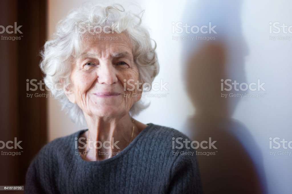 Senior Women with Gentle Smile stock photo