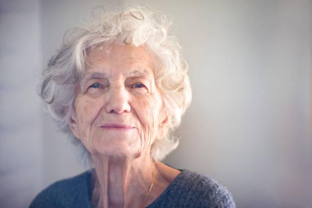 Senior Women with Gentle Smile stock photo