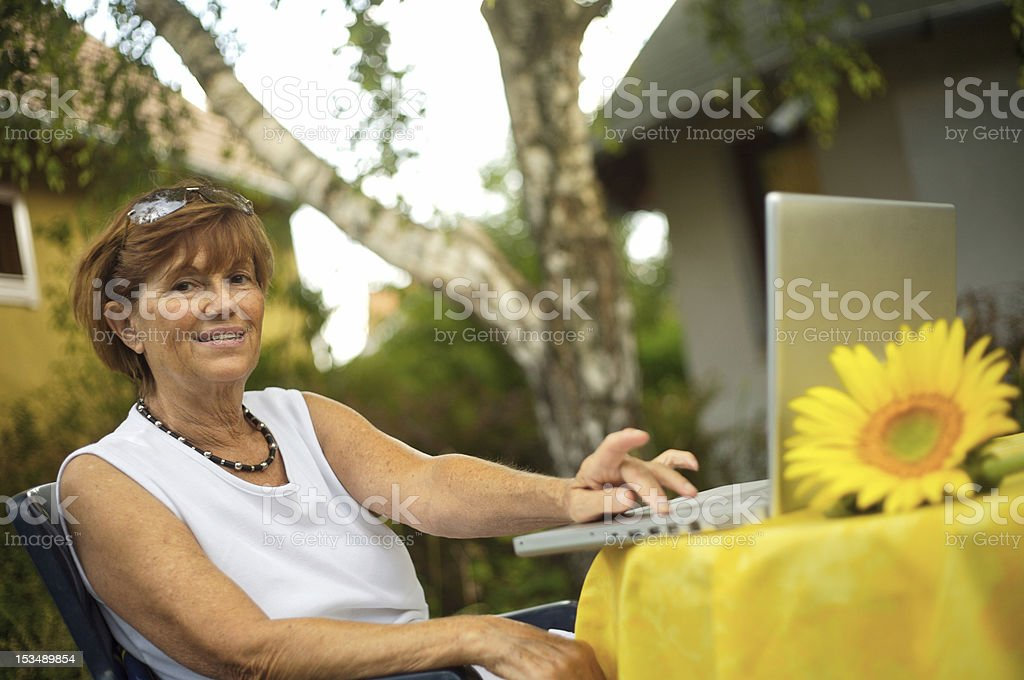 Senior women with laptop royalty-free stock photo