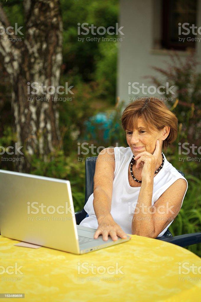Senior women with laptop royalty-free stock photo