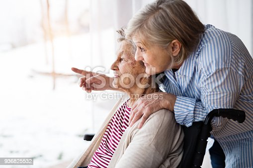 istock Senior women with wheelchair at home. 936825532