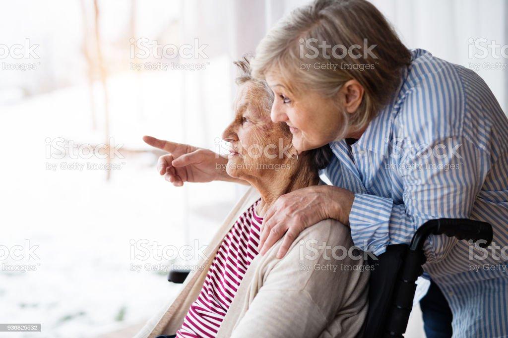 Senior women with wheelchair at home. stock photo