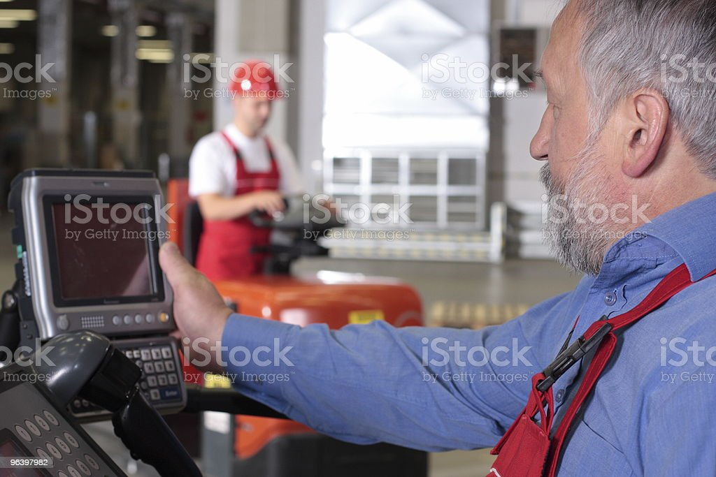 senior worker at control panel in factory royalty-free stock photo