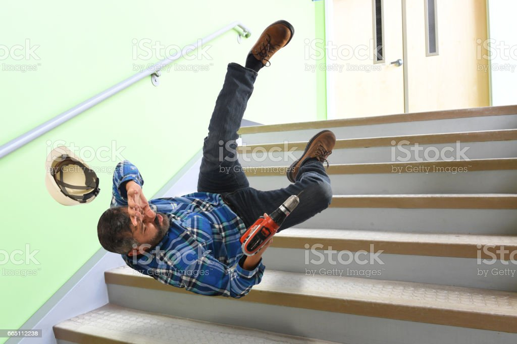 Senior Worker Falling on Stairs stock photo