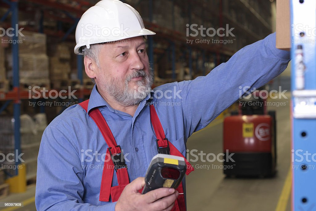 senior worker with bar code reader - Royalty-free Adult Stock Photo