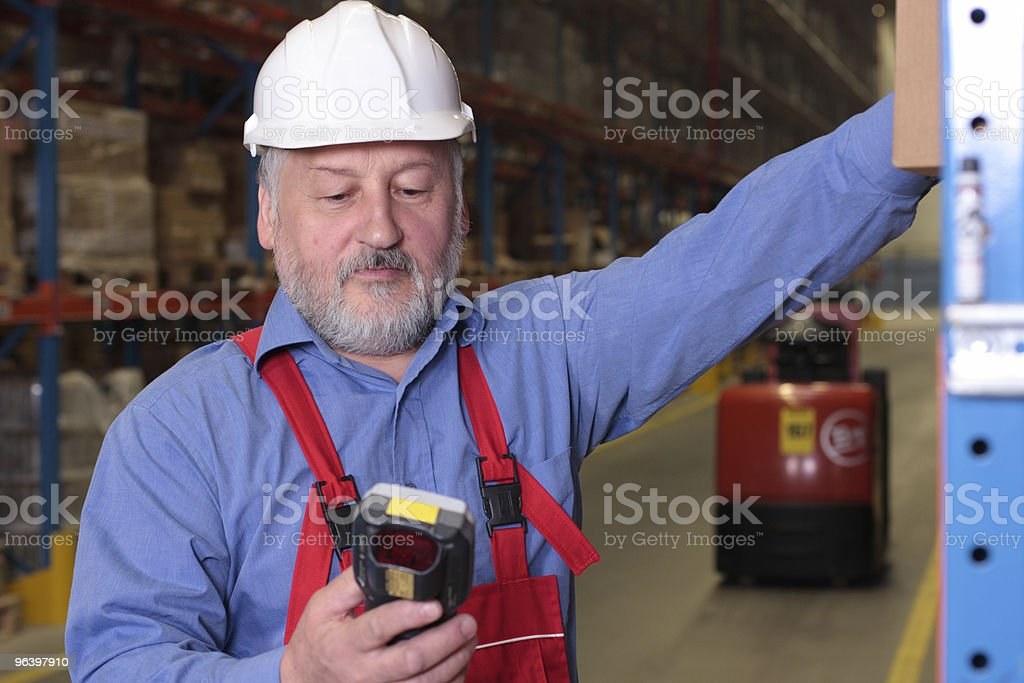 senior worker with bar code reader royalty-free stock photo