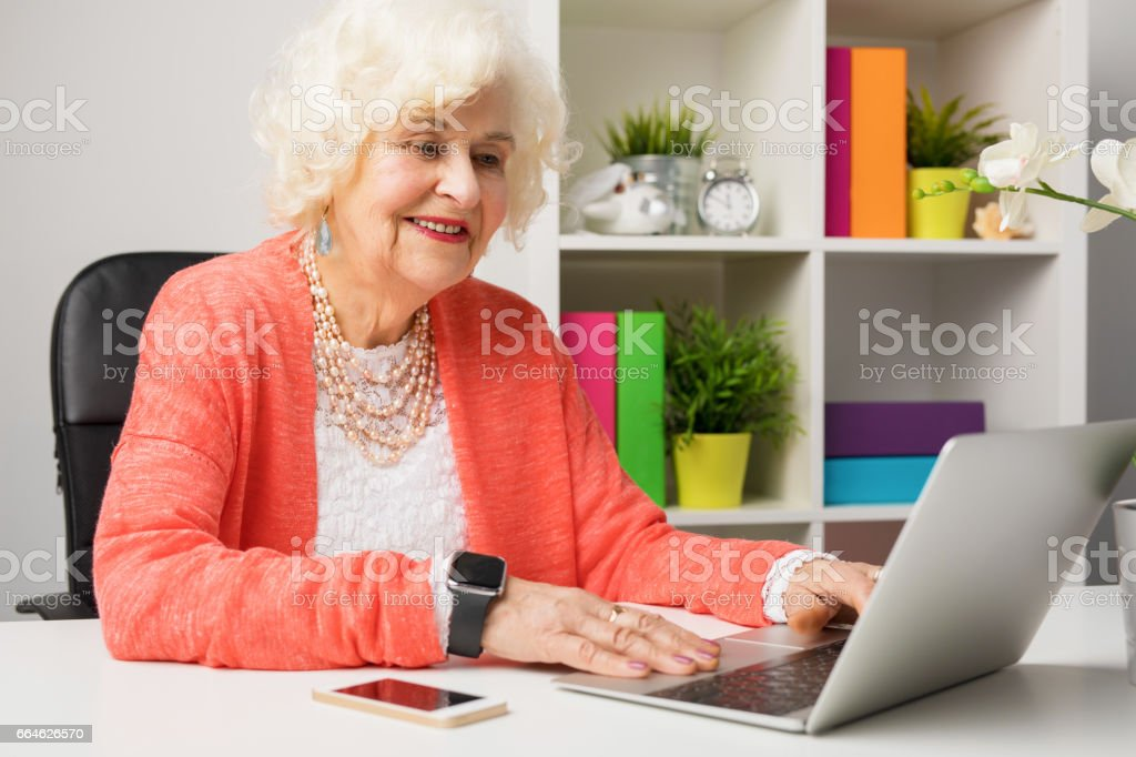 Senior working at the office stock photo