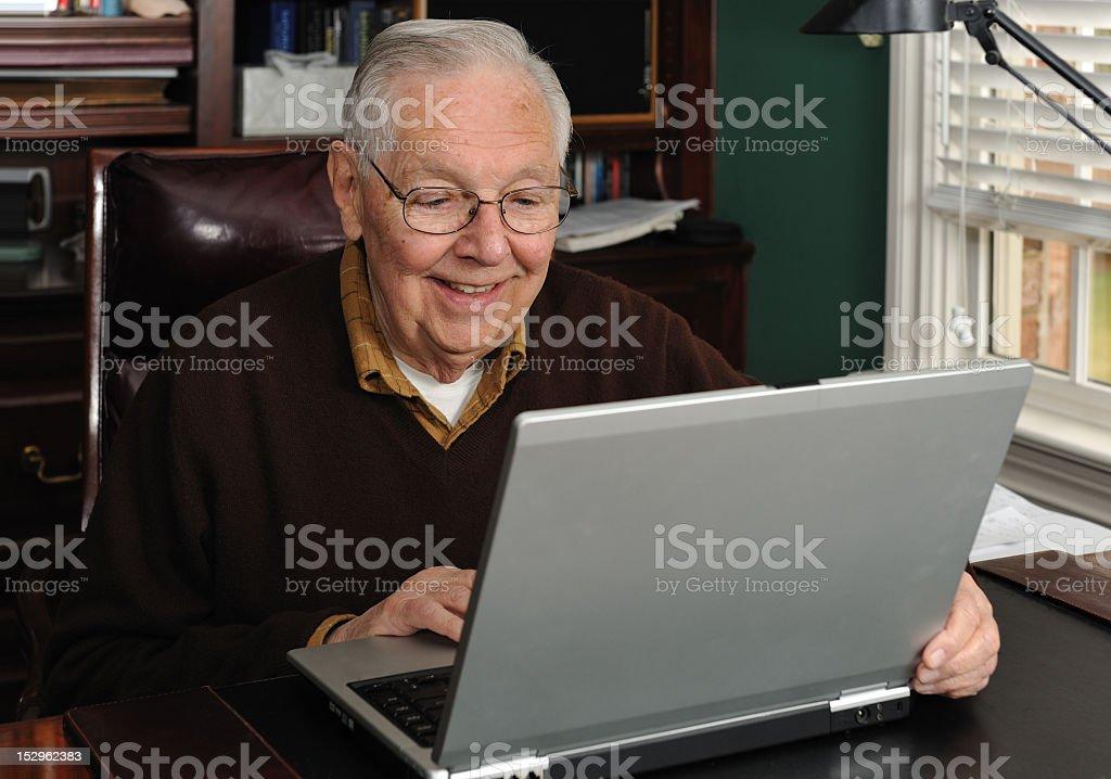 Senior working on a laptop royalty-free stock photo