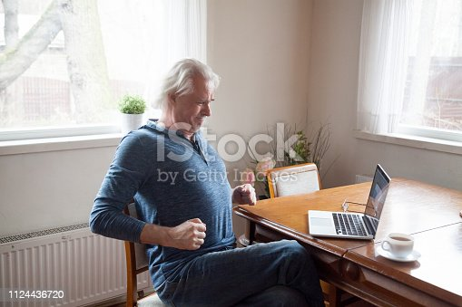 821012164istockphoto Senior working on computer having low back pain 1124436720