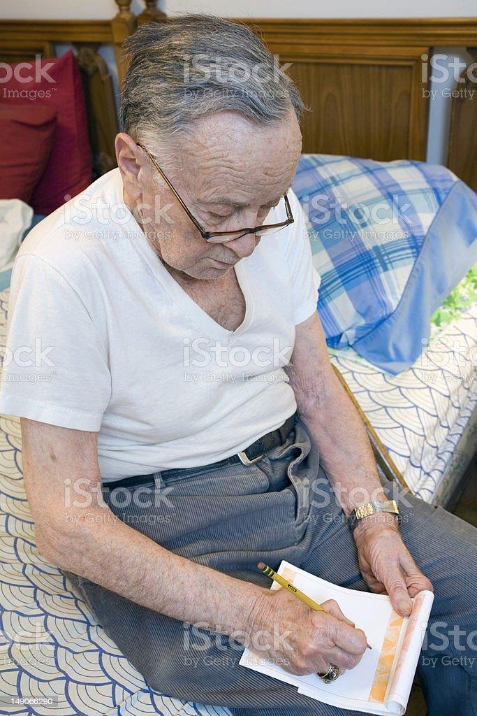 Senior writing stock photo