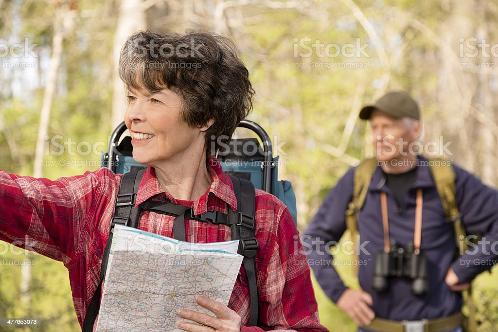 Seniors: Active senior couple hiking outdoors in forest. Nature. royalty-free stock photo