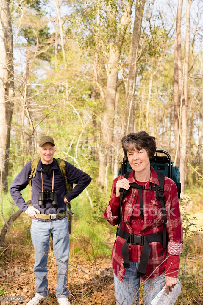 Seniors: Active senior couple outdoors hiking in forest. Nature. royalty-free stock photo