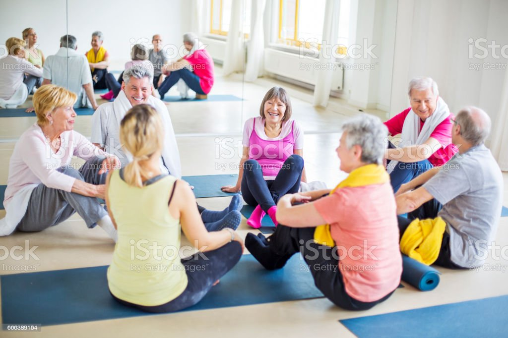 Seniors And Instructor Communicating In Gym Stock Photo & More