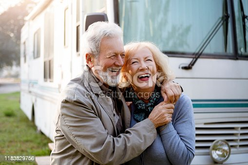 Seniors smiling in front of Luxury Motor Home ,recreational vehicle