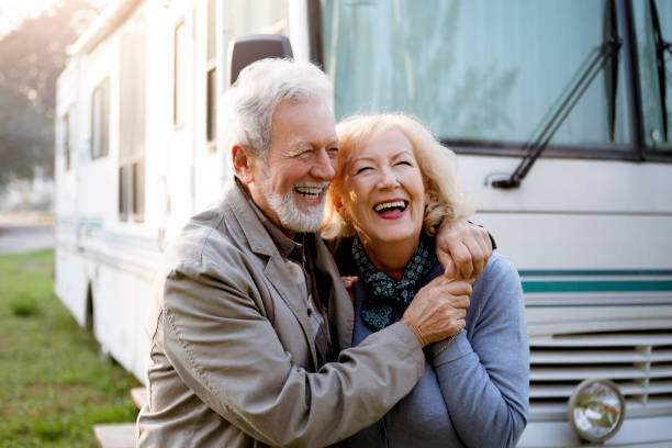 Seniors and Luxury Motor Home ,recreational vehicle Seniors smiling in front of Luxury Motor Home ,recreational vehicle motor home stock pictures, royalty-free photos & images