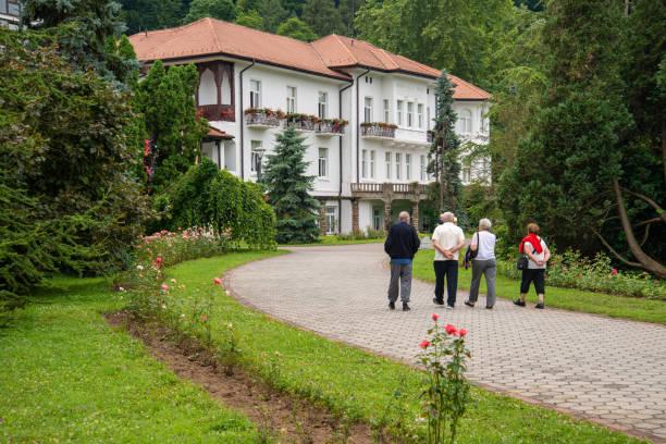 Seniors are strolling in Medical wellness center Banja Koviljaca, Serbia. stock photo