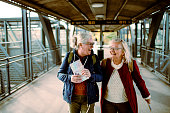 Close up of two seniors at a train station