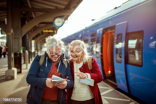 Close up of two seniors at a trainstation