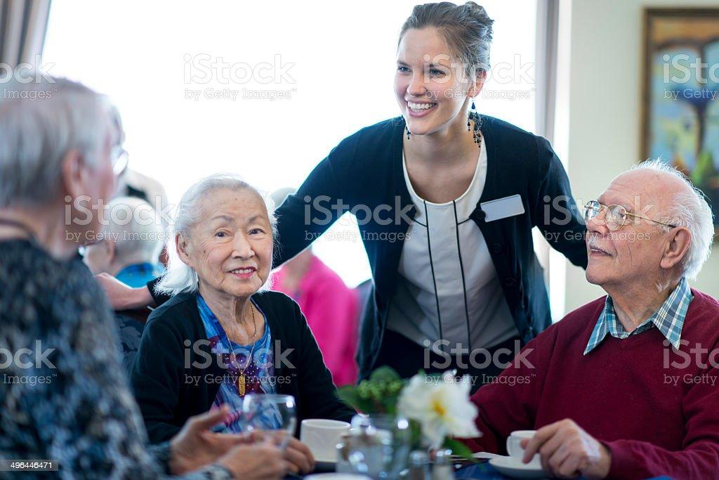 Seniors at restaurant stock photo