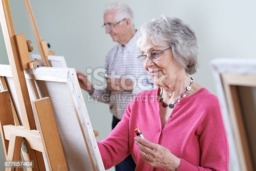 istock Seniors Attending Painting Class Together 577657464