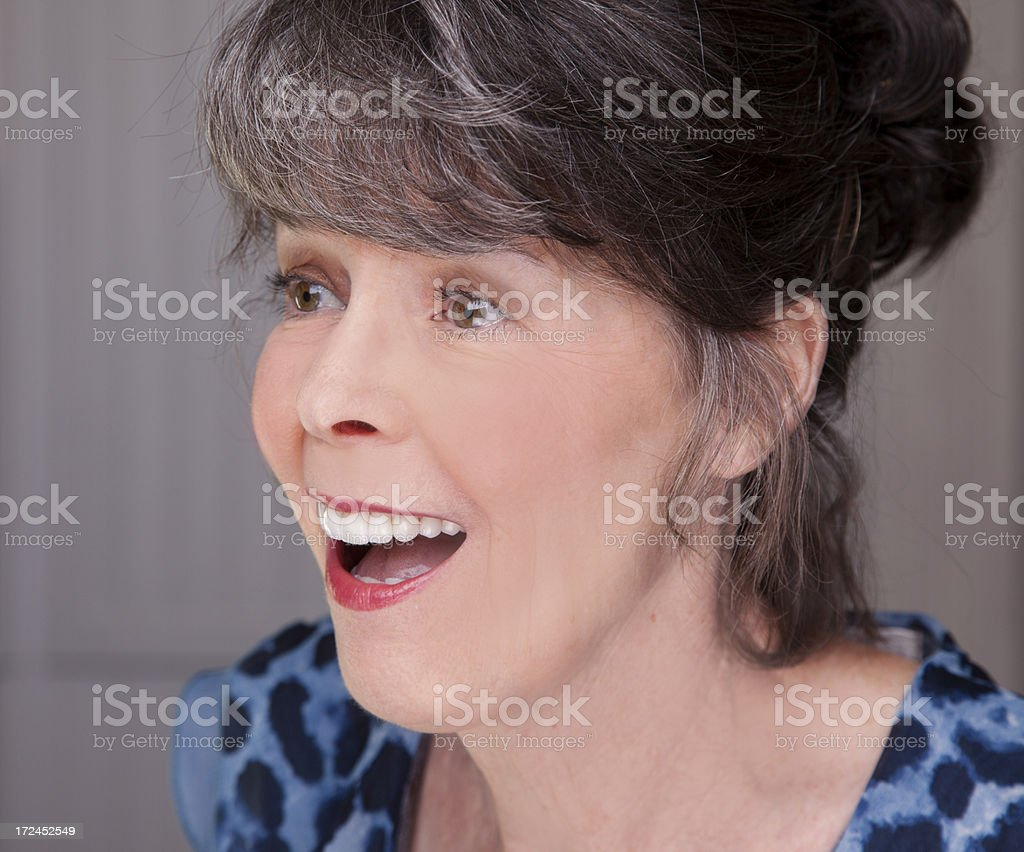 Seniors: Attractive senior woman talking to a friend. royalty-free stock photo