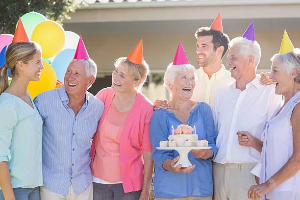 seniors celebrating a birthday - vorschulgeburtstag stock-fotos und bilder