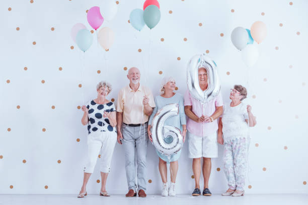 seniors celebrating birthday - 60 69 years stock photos and pictures