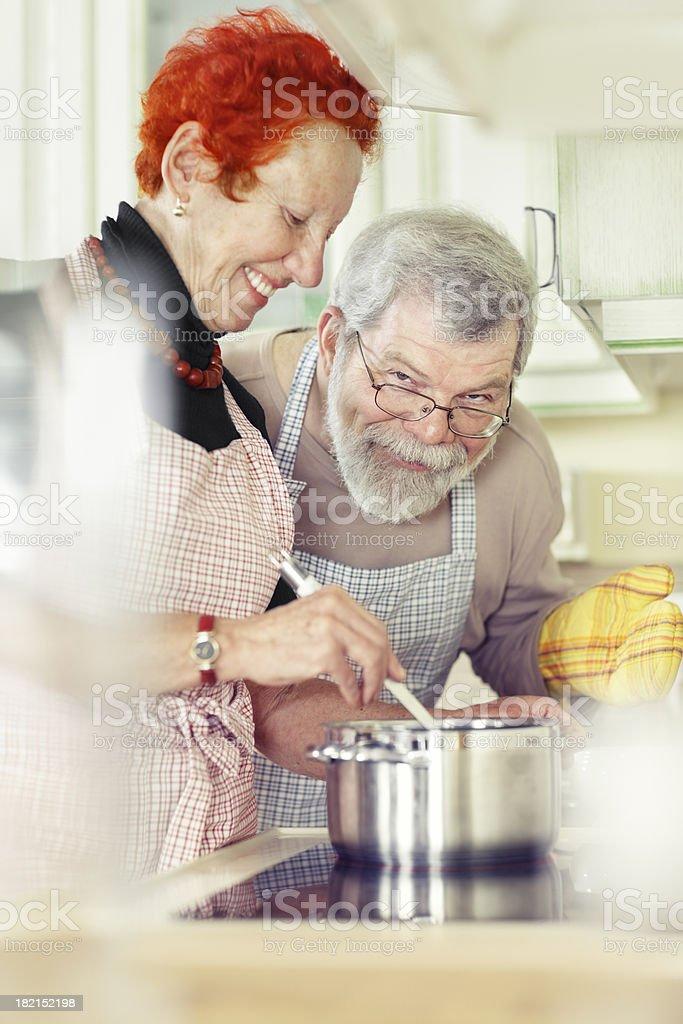 seniors cooking royalty-free stock photo