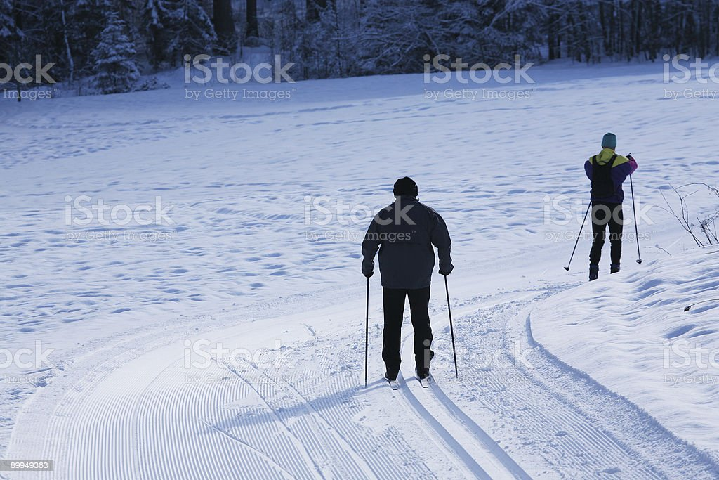 Seniors country-cross skiing royalty-free stock photo