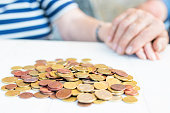 istock seniors couple hands with heaped money, pensions and savings 1132313057