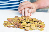 istock seniors couple hands with heaped money, pensions and savings 1132313082