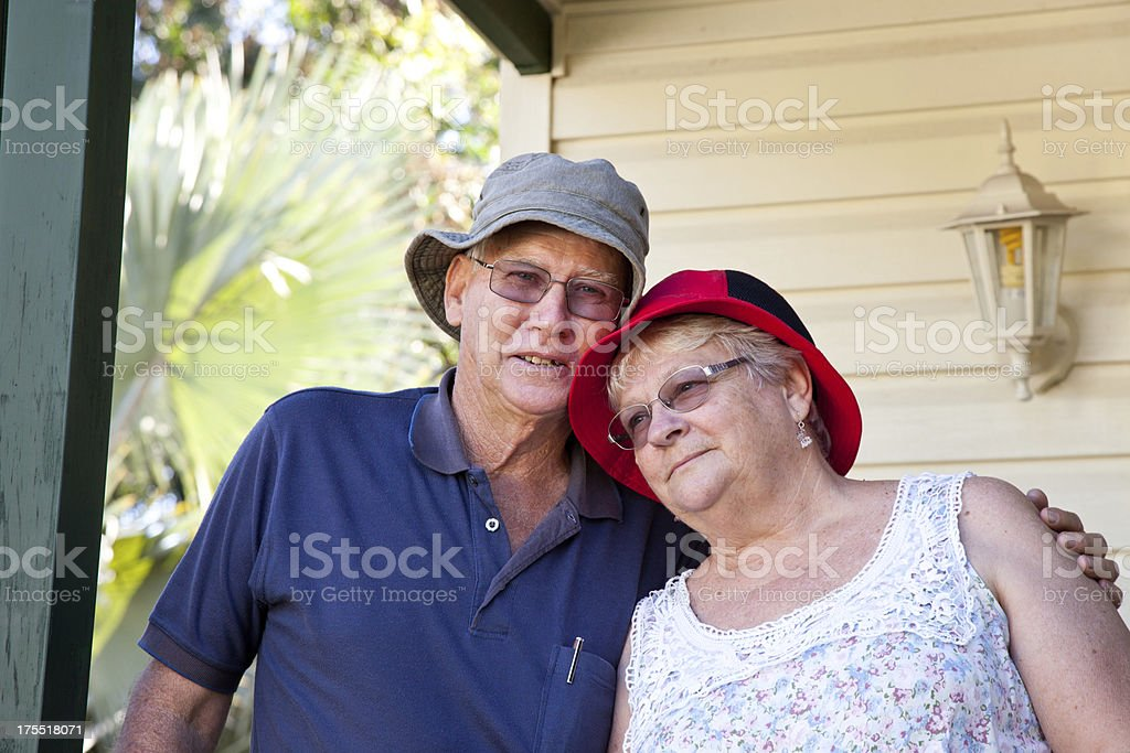 Seniors Couple in front of house home stock photo
