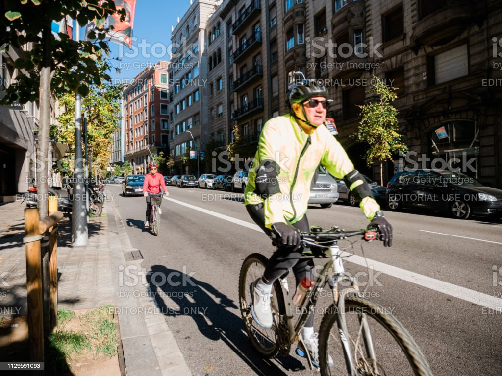 Seniors Cycling In Central Barcelona Morning Fitness Stock Photo Download Image Now Istock