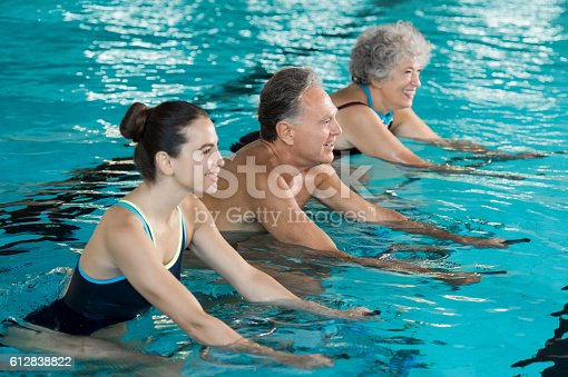 612839448istockphoto Seniors cycling on aqua bike 612838822