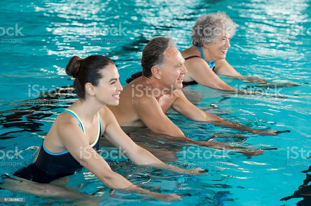 Seniors cycling on aqua bike - foto de stock