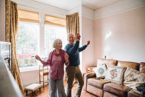 Seniors Dancing At Home stock photo