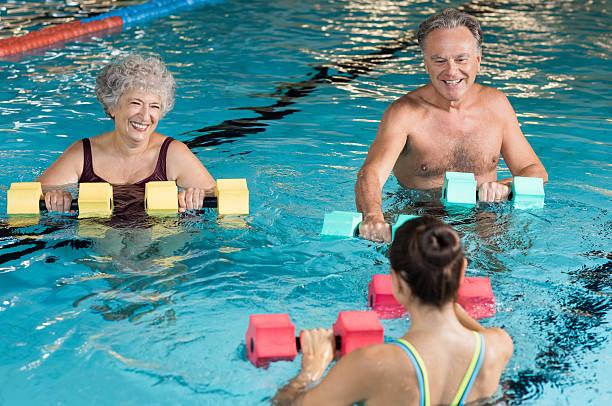 Seniors doing aqua aerobics - foto stock