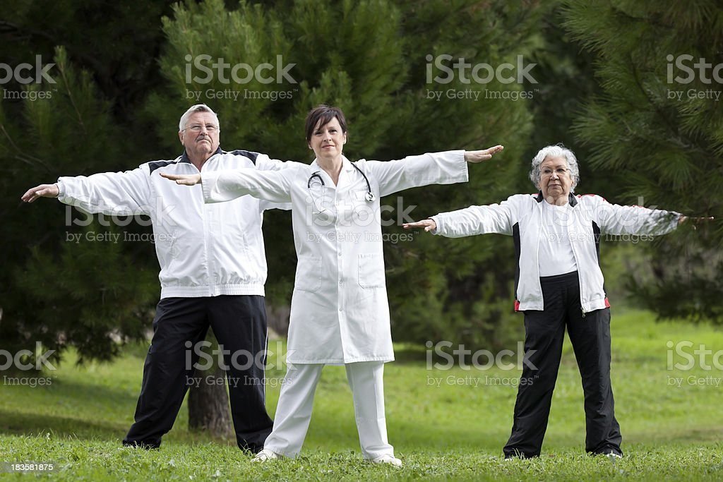 seniors doing exercise with the doctor royalty-free stock photo