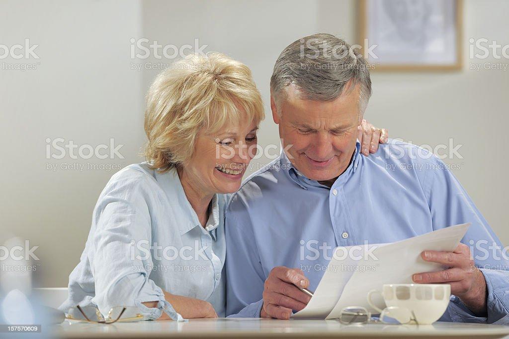 seniors doing paperwork royalty-free stock photo