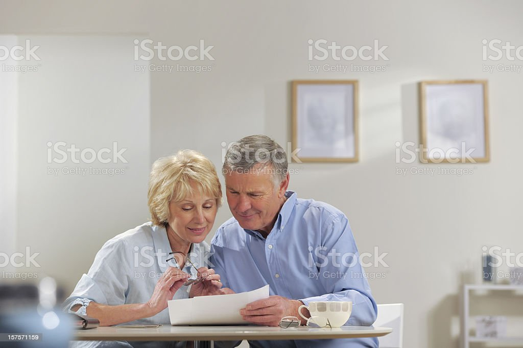 seniors doing paperwork royalty-free stock photo
