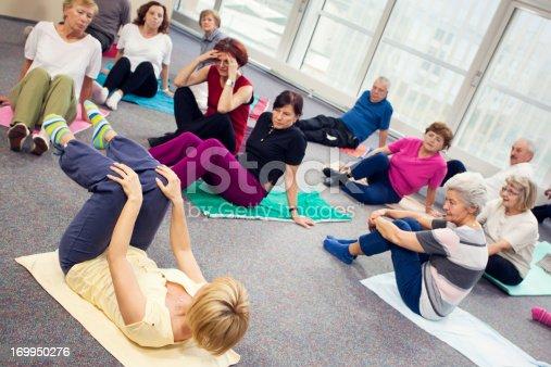 1047537292istockphoto Seniors Doing Pilates Exercises 169950276