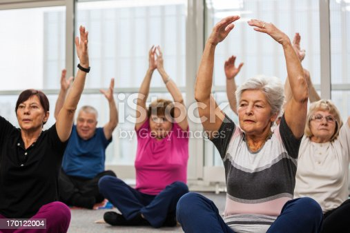 1047537292istockphoto Seniors Doing Pilates Exercises 170122004