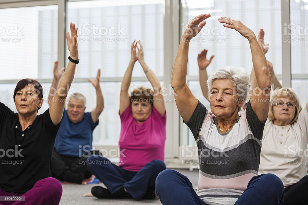 Seniors Doing Pilates Exercises stock photo