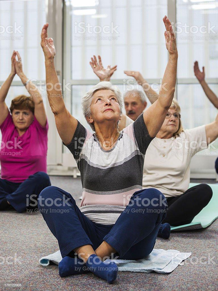 Seniors Doing Pilates Exercises stock photo
