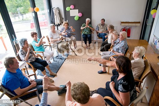 istock Seniors Doing Relaxation Exercises In The Elderly Day Care Center 650383412