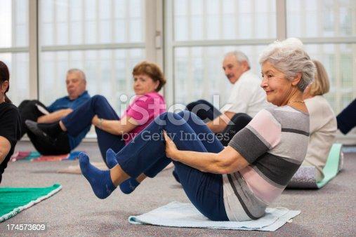 1047537292istockphoto Seniors Doing Stretching Exercises 174573609