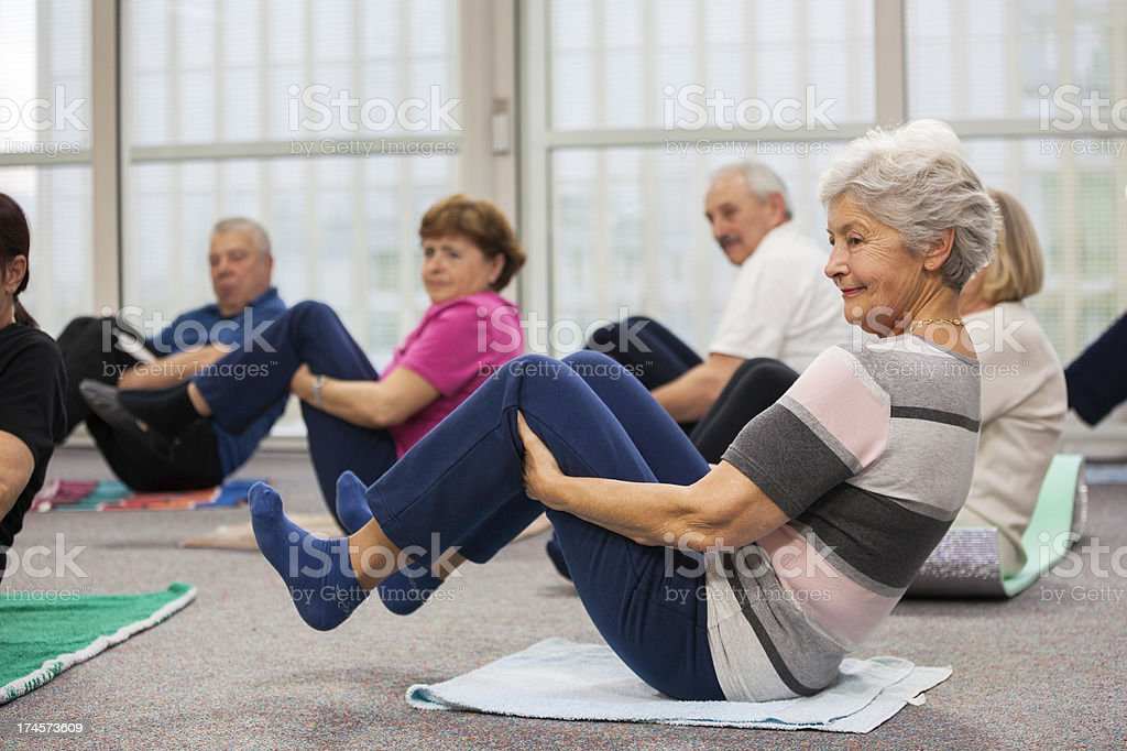 Seniors Doing Stretching Exercises stock photo