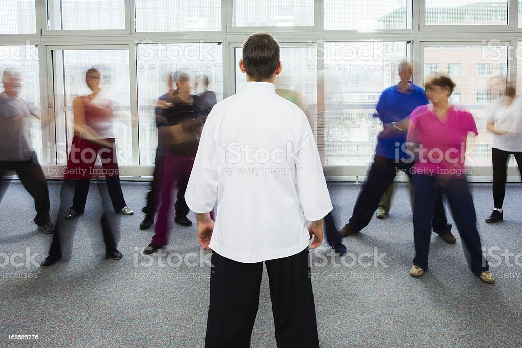 Seniors Doing Tai Chi Exercises royalty-free stock photo