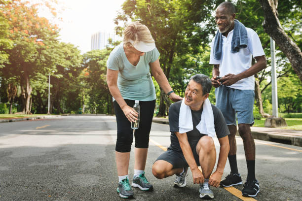 seniors exercising in the park - relaxation exercise stock photos and pictures