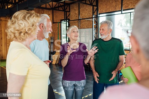 1047537292 istock photo Seniors gathering for a yoga class 1212075393